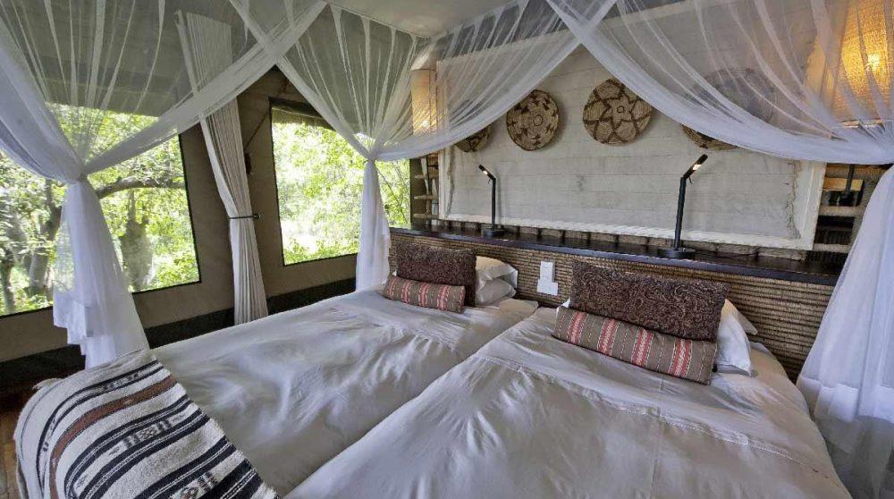 Lits dans une chambre au Savuti Camp