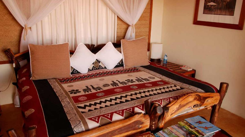 Un lit dans une chambre du Loisaba