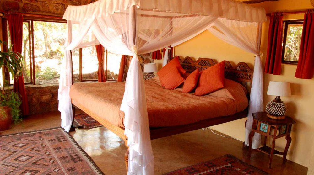 Le lit du cottage à Waterberg