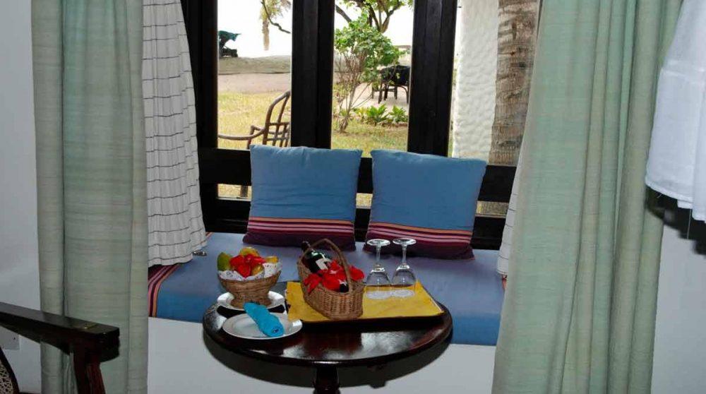 Vue sur le jardin depuis une chambre de l'Indian Ocean Beach Club