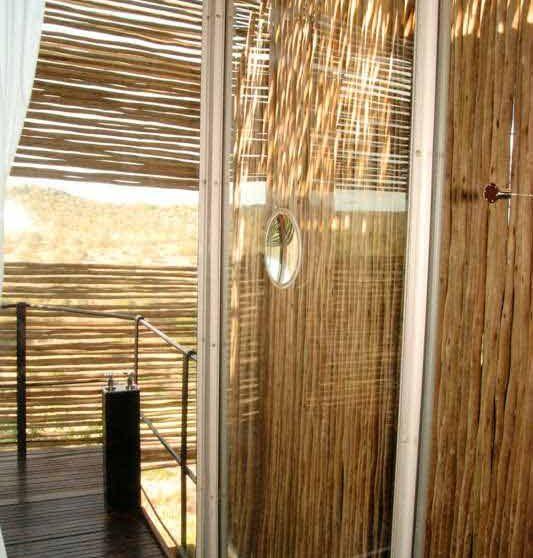 Une douche dans une suite du Singita Lelombo